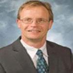 Dr. PETER KOULEN
